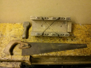 Mitre box and small saw