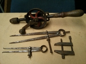 Hand drill, calipers, hand screw clamp